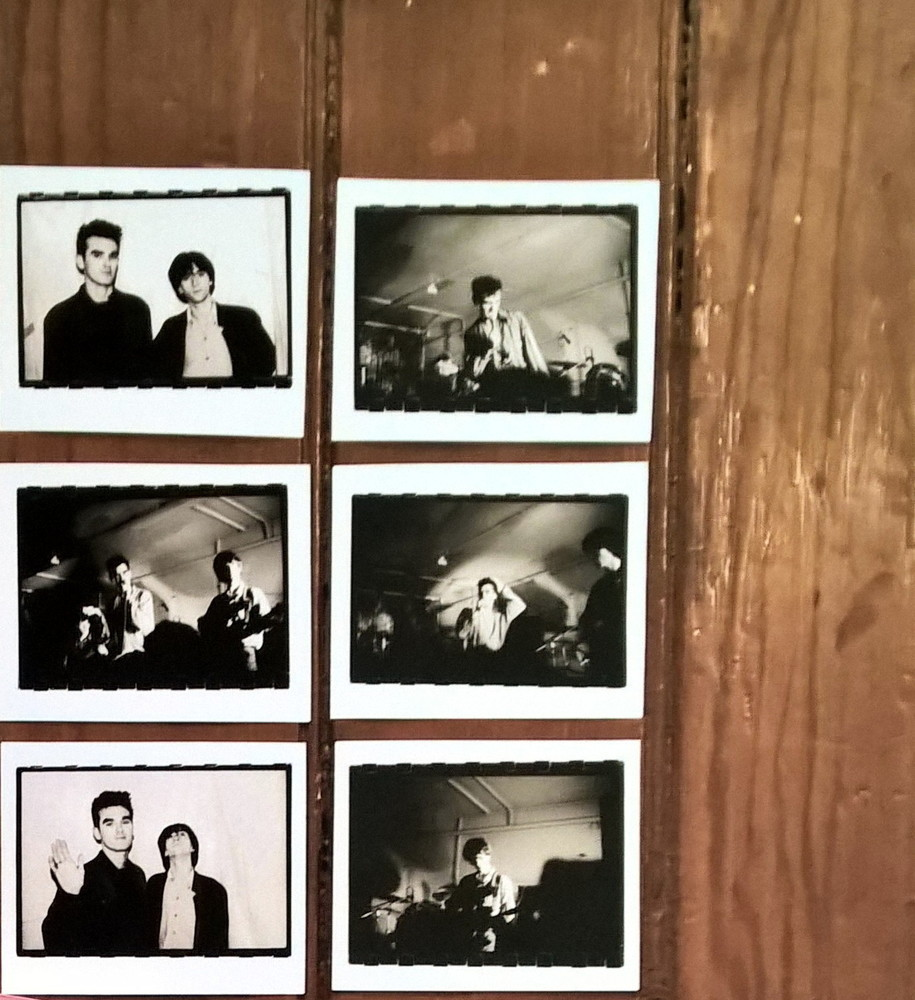 1983 photos of Morrissey and Johnny Marr tacked to The Smiths Room door
